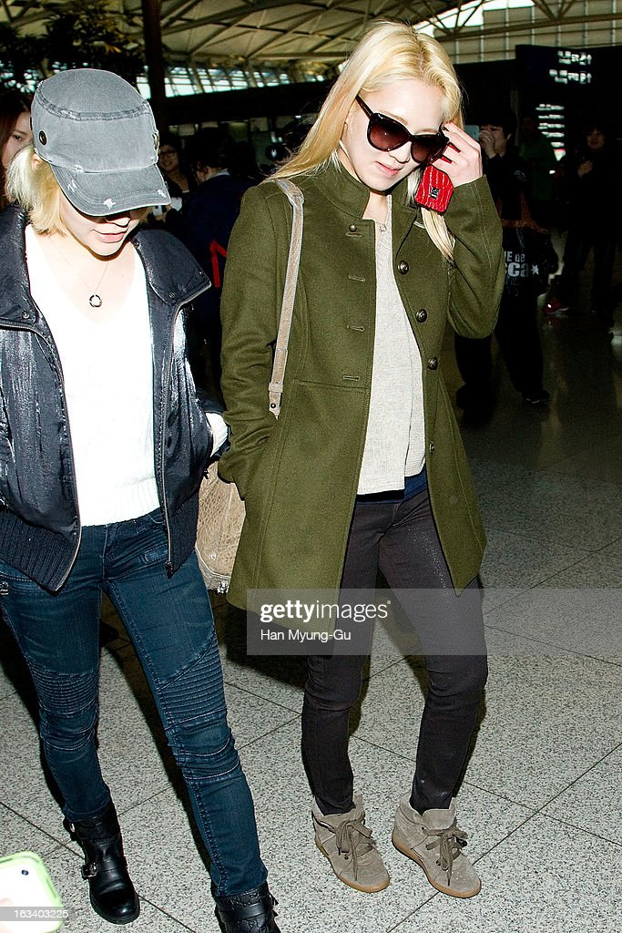 Sunny and Hyoyeon of South Korean girl group Girls' Generation are seen on departure at Incheon International Airport on March 8, 2013 in Incheon, South Korea.