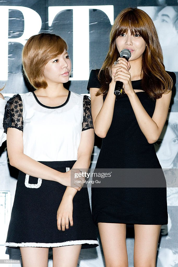 Sunny and Soo Young of South Korean girl group Girls' Generation attend during the 'S.M.ART Exhibition' opening ceremony held at Coex on August 09, 2012 in Seoul, South Korea.