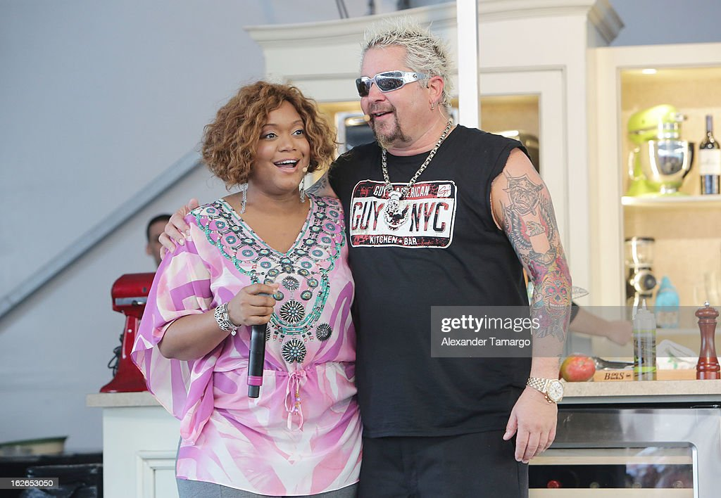 Sunny Anderson and Guy Fieri attend South Beach Wine and Food Festival 2013 Grand Tasting Village on February 24, 2013 in Miami Beach, Florida.