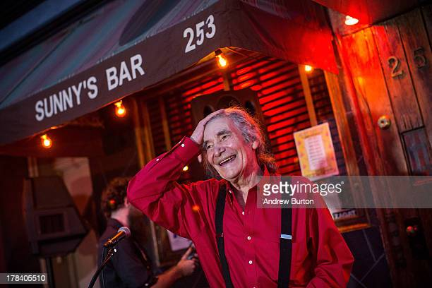Sunny Balzano owner of Sunny's Bar a landmark bar that has been open for over a century reacts to a crowd of friends family and patrons who have...