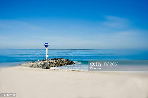 Sunny day blue ocean selective focus on the beach