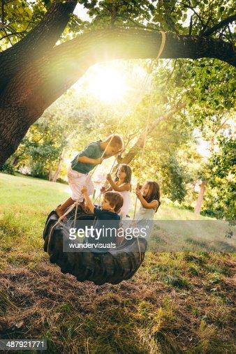 Sunny day kids swinging