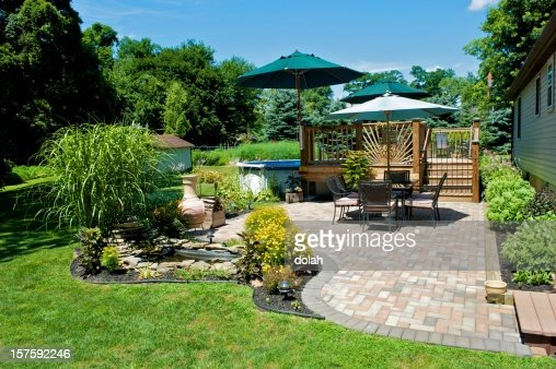 Sunny day on a terrace with table and sun umbrella