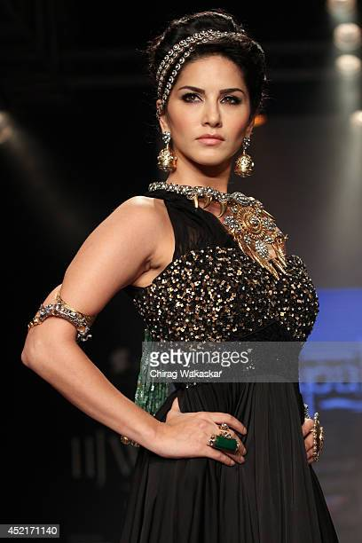 Sunny Leone walks the runway at the Apala show during day 1 of the India International Jewellery Week 2014 at grand Hyatt on July 14 2014 in Mumbai...