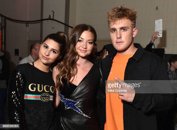 Sunny Malouf Erika Costell and Jake Paul attend Z100's Jingle Ball 2017 backstage on December 8 2017 in New York City