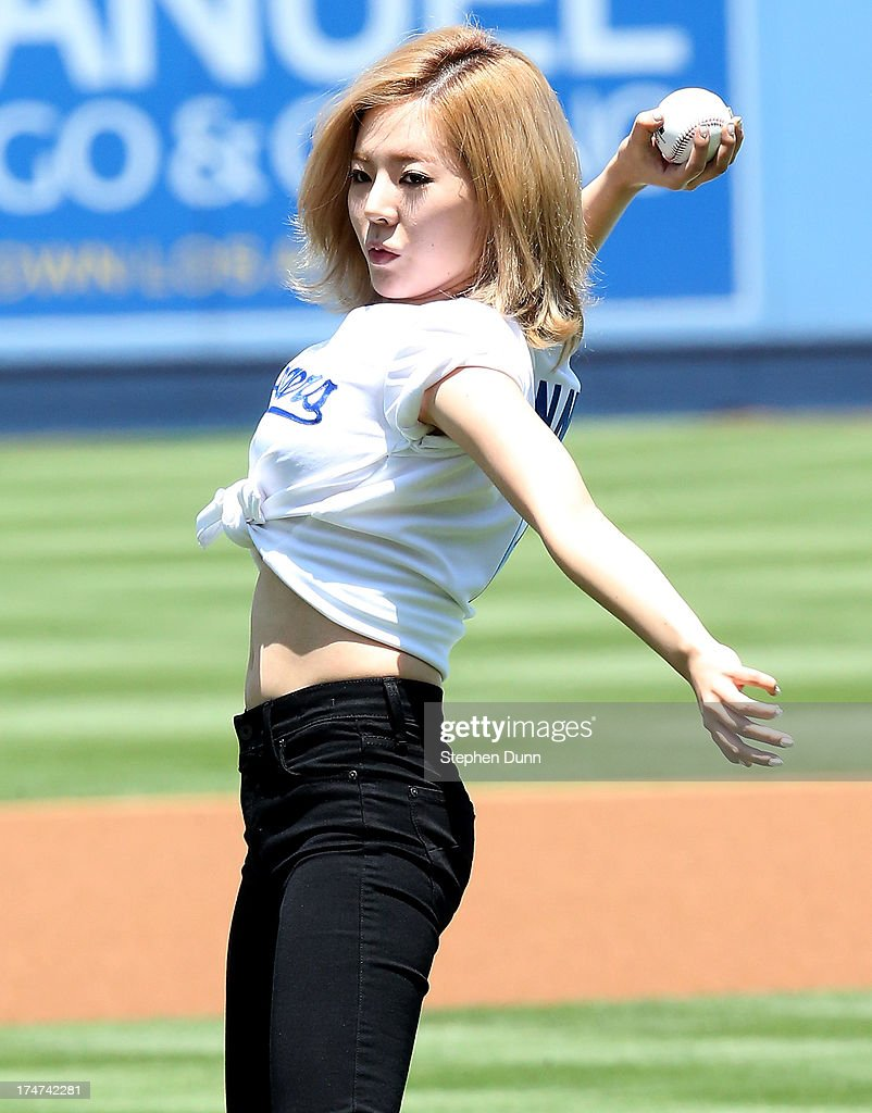 Sunny of Korean Pop group Girls Generation throws out the first pitch during Korea Day ceremonies before the game between the Cincinnati Reds and the Los Angeles Dodgers at Dodger Stadium on July 28, 2013 in Los Angeles, California.