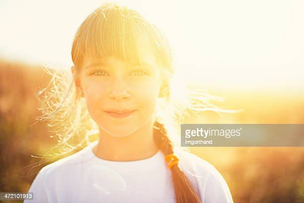 Sunny portrait of a little girl
