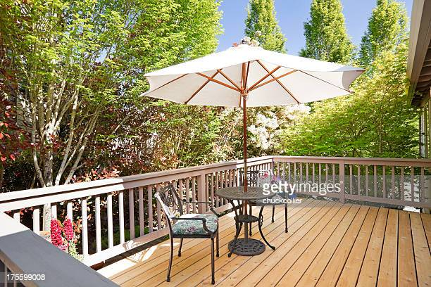 Sunny second floor back deck with breakfast table
