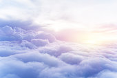 Sunny sky abstract background, beautiful cloudscape, on the heaven, view over white fluffy clouds, freedom concept