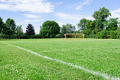 image of a soccer field on a sunny day