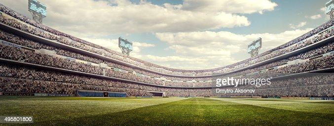Sunny soccer stadium panorama