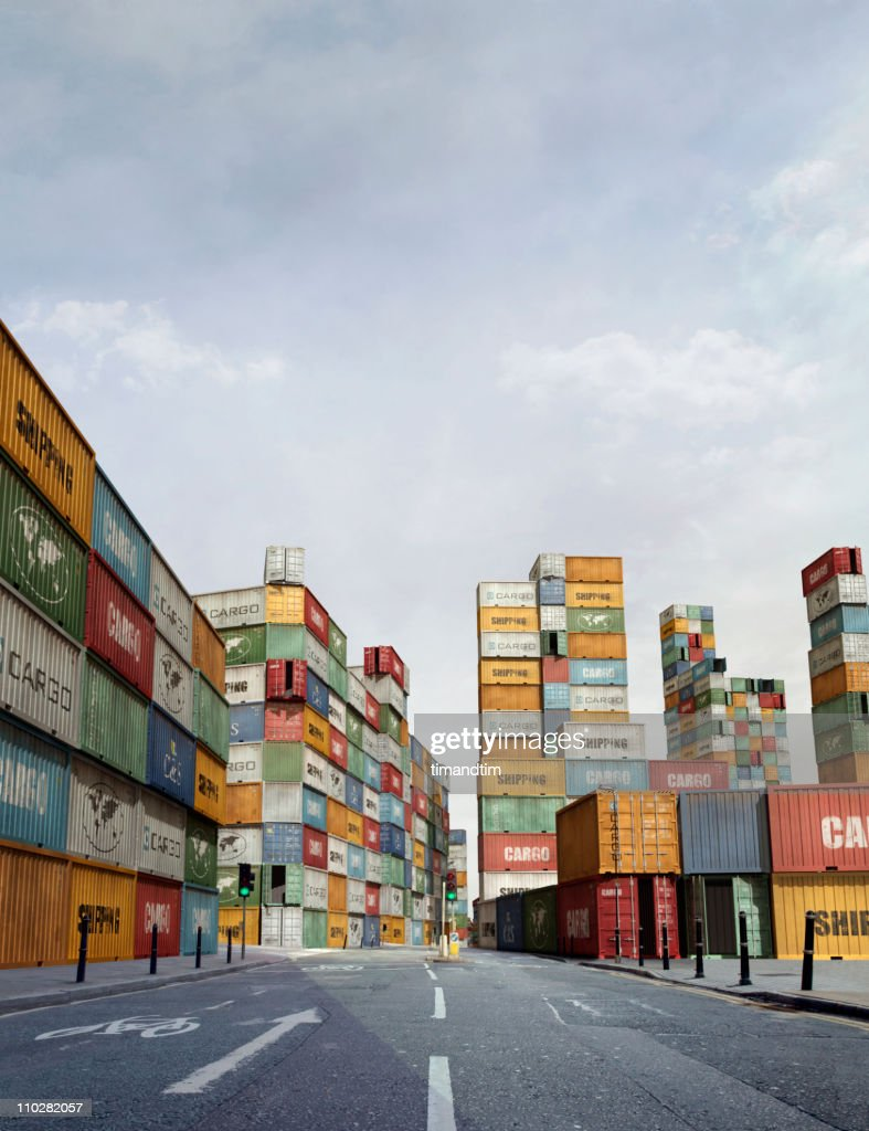 Sunny street in a city of cargo containers : Stock Photo