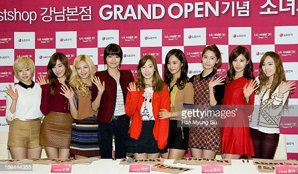 Sunny Tiffany Hyoyeon Sooyoung Taeyeon Kwon YuRi Yoona Seohyun and Jessica of South Korean girl group Girls' Generation attend during an autograph...