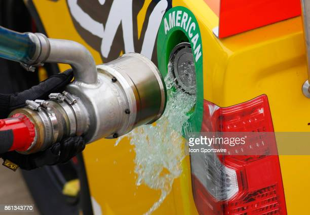 Sunoco racing fuel spills from the gas can on the truck of Chris Fontaine Glenden Enterprises Toyota Tundra during the Fred's 250 NASCAR Camping...