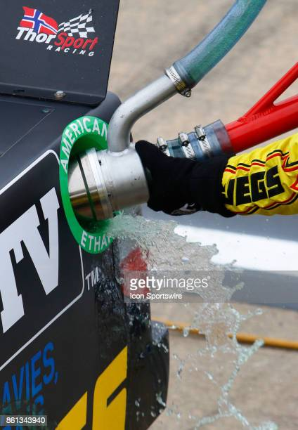 Sunoco racing fuel spills from the gas can while refueling the truck of Cody Coughlin Ride TV/ Jegs Toyota Tundra during the Fred's 250 NASCAR...