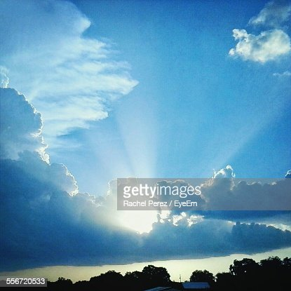 Sunrays Emitting Through Clouds On Field