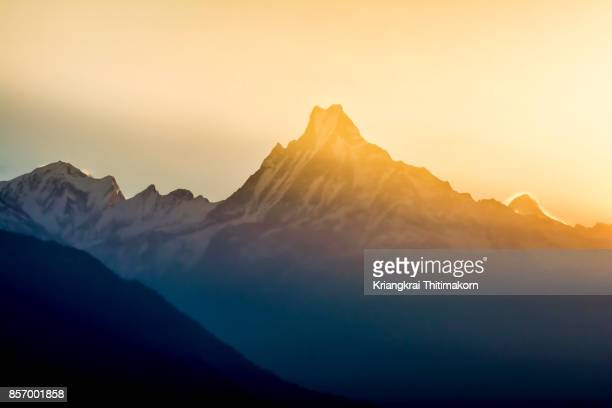 Sunrise accros over the Machapuchare mountain in Nepal.