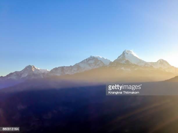 Sunrise across Annapurna Massif Mountain range in Nepal.