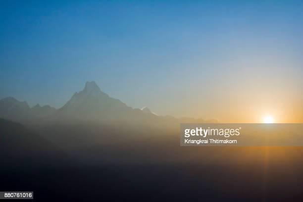 Sunrise across Machapuchare mountain in Nepal.