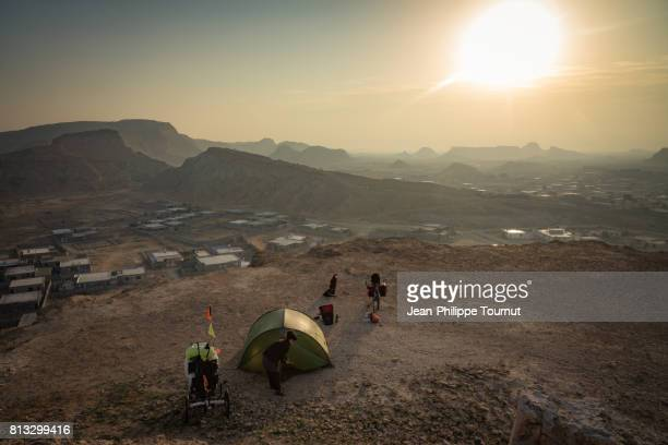 Sunrise after bivouac on top a hill overlooking the town of Bandar-e-Laft, Qeshm Island, Persian Gulf, Hormozgan Province, Southern Iran