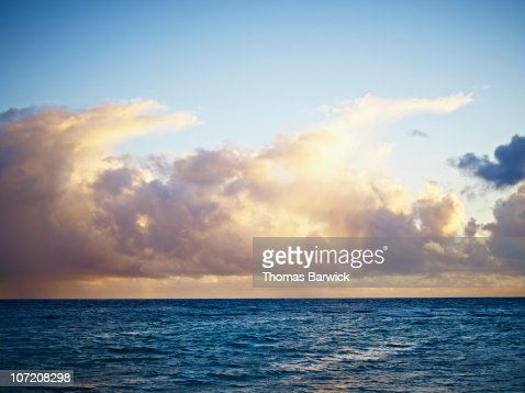 Sunrise and clouds over ocean : Stock Photo