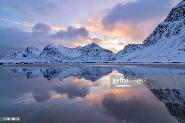Sunrise and Mountains Reflected in Sand