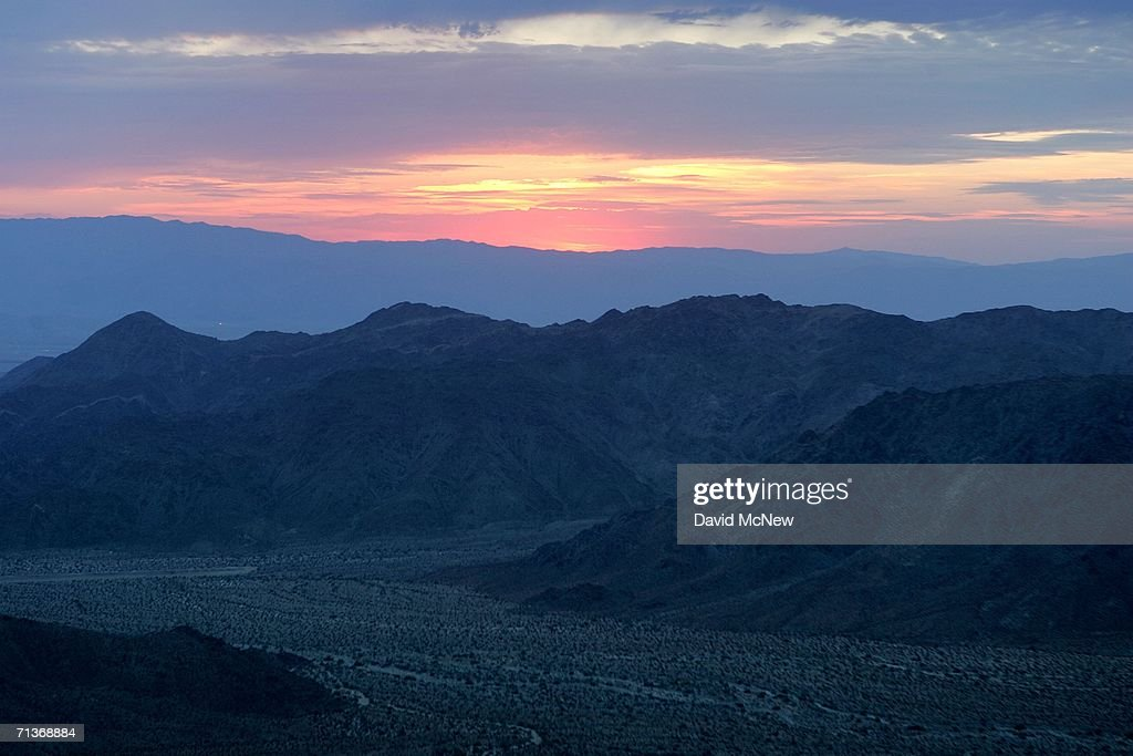 Sunrise approaches at a canyon in the Santa Rosa Mountains on the south side of Coachella Valley where desert cities such as Palm Desert and Palm Springs may be threatened by a major earthquake on the southern San Andreas Fault on July 4, 2006 near Palm Desert, California. Scientists have warned that after more than 300 years with very little slippage, the southern end of the 800-mile-long San Andreas fault north and east of Los Angeles has built up immense pressure and could produce a massive earthquake at any time. Such a quake could produce a sudden lateral movement of 23 to 32 feet which would be would be among the largest ever recorded. By comparison, the 1906 earthquake at the northern end of the fault destroyed San Francisco with a movement of no more than about 21 feet. Experts have concluded that a quake of magnitude-7.6 or greater on the lower San Andreas could kill thousands of people in the Los Angeles area with damages running into the tens of billions of dollars. The San Andreas Fault is where the Pacific and the North American tectonic plates of the Earth?s crust collide.