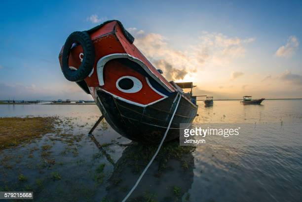 Sunrise at lake over a fishing boat