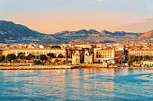 Sunrise at the Mediterranian sea and Palermo old city, Sicily island in Italy