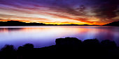 Sunrise at Pyramid Lake, Nevada. Colorful sky and calm water.