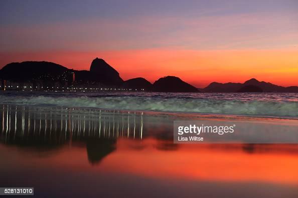Sunrise at Rio de Janeiro's Copacabana beach Copacabana with Sugar Loaf mountain in the distance Rio de Janeiro Brazil 11th December 2011 Photo by...