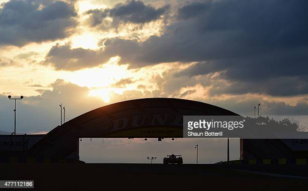 Sunrise at the Dunlop bridge during the Le Mans 24 Hour race at the Circuit de la Sarthe on June 14 2015 in Le Mans France