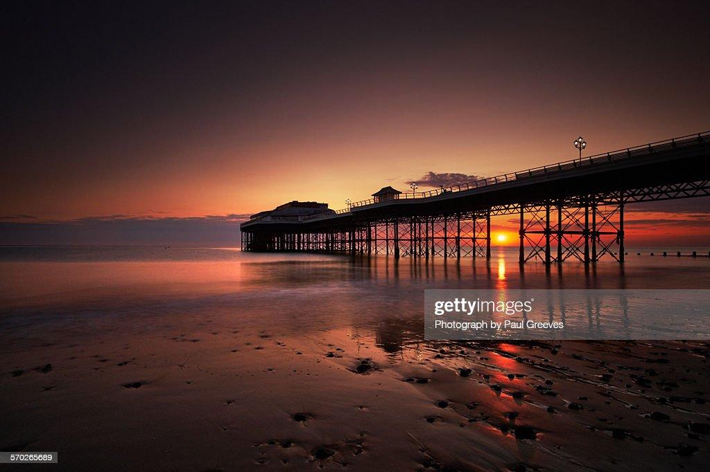 Sunrise beneath Cromer pier