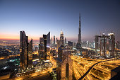 Sunrise colors over Dubai Downtown district during dawn. Dubai, UAE.