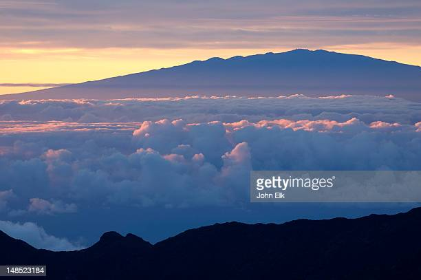 Sunrise from crater rim with clouds.