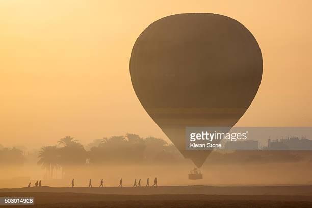 Sunrise Hot air balloon in the desert haze