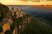 "View over the landmark rock formation ""Three sisters"" in Blue Mountains, NSW, Australia on sunrise."