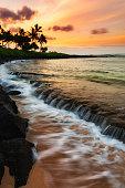 A beautiful sunrise at the beach on the south shore of Kauai, Hawaii.