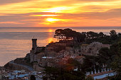 Sunrise in sea Tossa de Mar with the wall and the castle near the sea