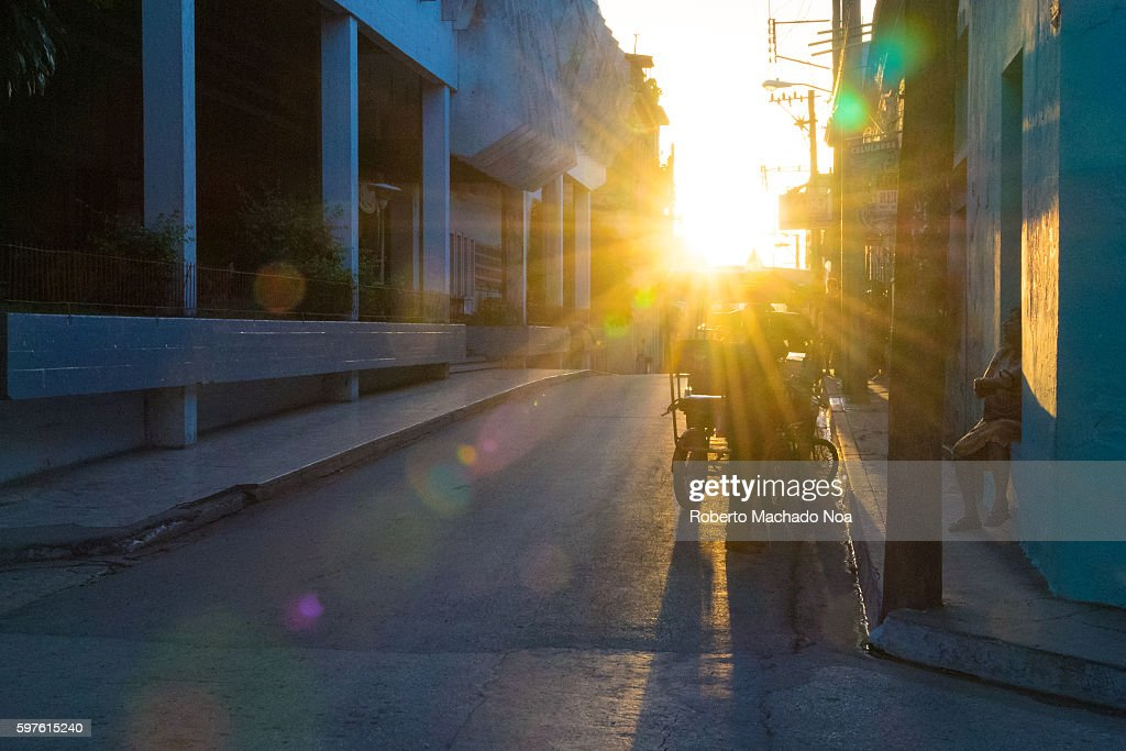 Sunrise in the Coppelia street as people prepare for another day of work Cuban lifestyle or way of life