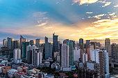 sunrise in the makati city , philippines