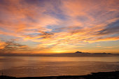 Sunrise in the sea for background. Silhouette of Teide peak, Tenerife, Canary islands, Spain.