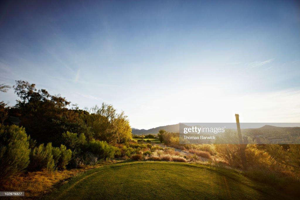 Sunrise looking down fairway of desert golf course : Stock Photo