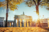 sunrise on Brandenburger Tor in Berlin in golden autumn
