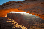 Sunrise on Cayonlands Mesa Arch in Utah.
