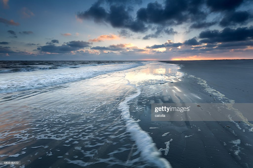sunrise on North sea beach : Stock Photo