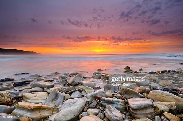 Sunrise on rocky beach