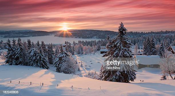 Sunrise on snow covered village Sjusjøen