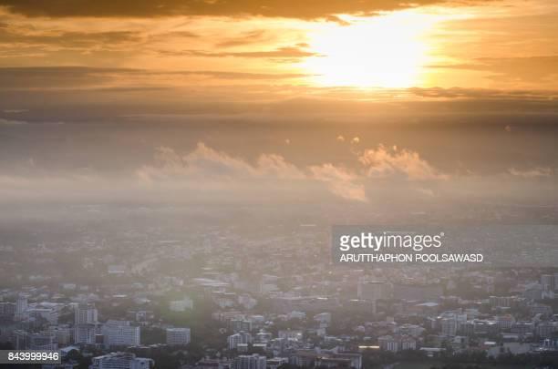 Sunrise on the mountain with city , Chiangmai Thailand