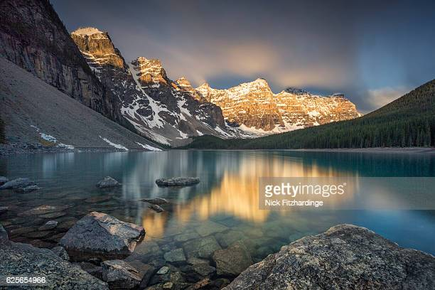 Sunrise on the mountains reflected in Moraine Lake, Banff national Park, Alberta, Canada